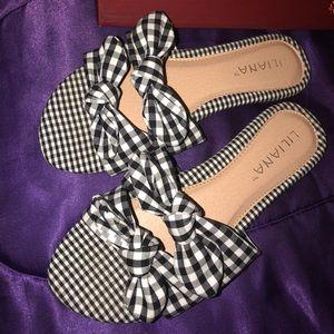 Shoes - Checkerd flip flops.